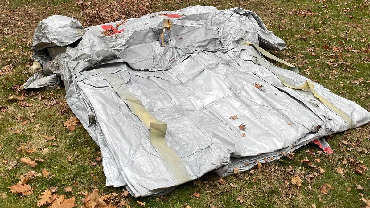 Evacuation slide falls off plane midflight, lands in Massachusetts man's front yard