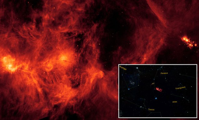 Is space on FIRE? NASA's Spitzer Telescope captures a massive collection of glowing gas and dust