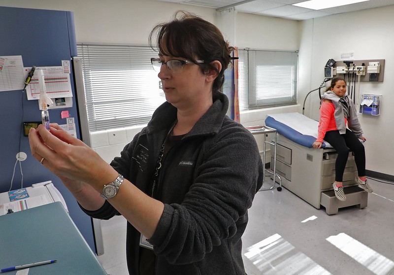Flu activity picks up in Georgia as death toll rises