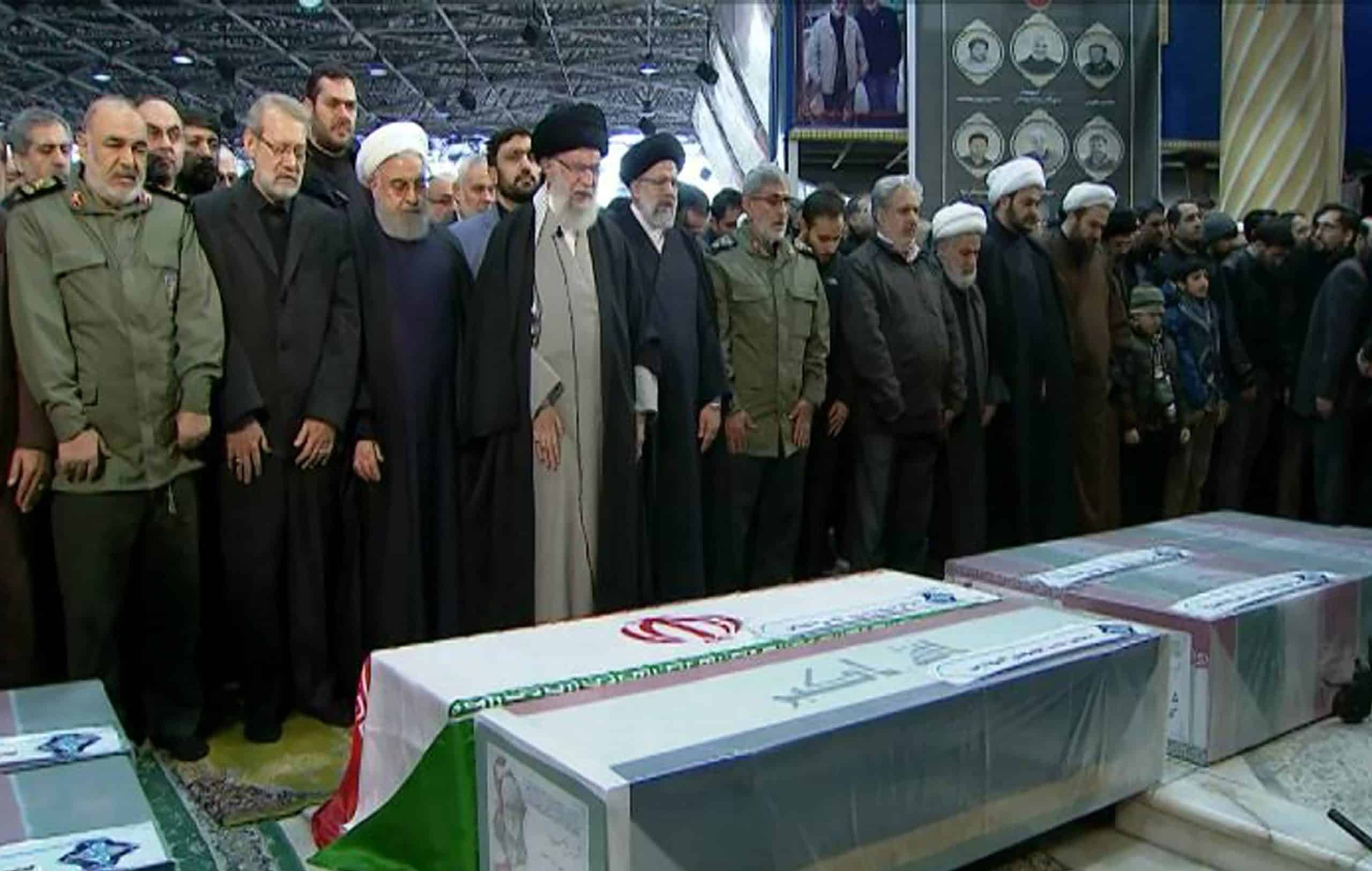 Weeping, Iran supreme leader prays over general slain by US