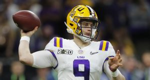 The Latest: Burrow sets record, LSU leading Clemson 35-25