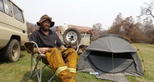 Australian village scorched by wildfires struggles with loss