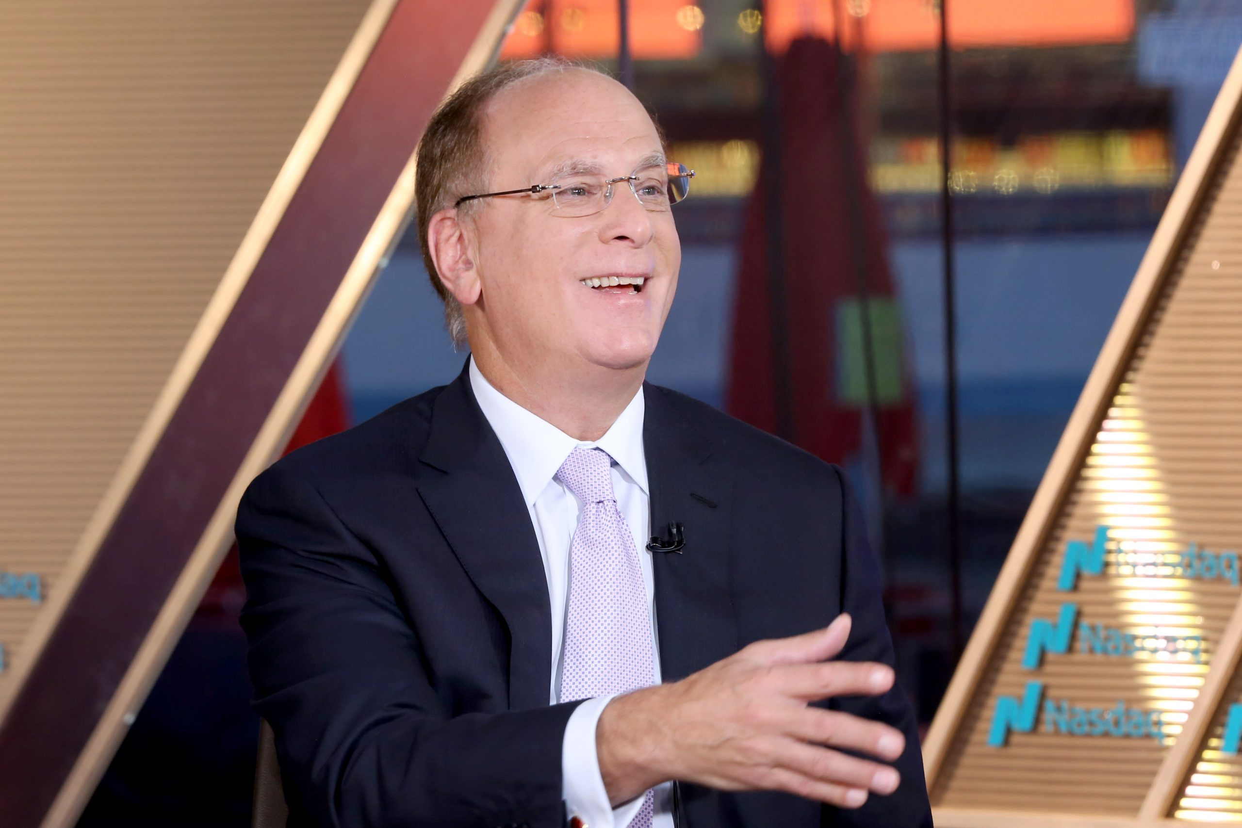 Larry Fink: Risks from climate change are bigger than the 2008 financial crisis with no Fed to save us