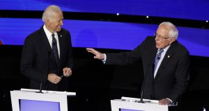 The Latest: Biden to Sanders: 'Be candid' about health costs