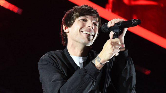 Against All Odds, Louis Tomlinson Stands Tall On His Emotional New Song 'Walls'