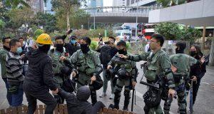 Hong Kong police fire tear gas as thousands rally