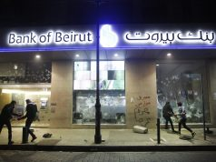 Facing humiliating controls, Lebanese focus fury on banks