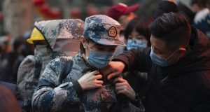 Virus death toll in China rises to 56 with about 2,000 cases
