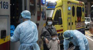 Hong Kong leader declares citywide virus emergency over coronavirus, first cases appear in Australia