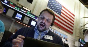 Stocks drop amid uncertainty over virus impact; Amazon soars