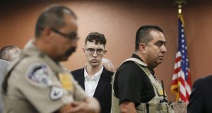 AP source: Walmart shooting suspect faces hate crime charges