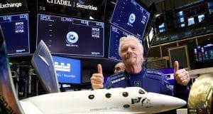 Stocks making the biggest moves midday: Apple, Legg Mason, Virgin Galactic, Tesla and more