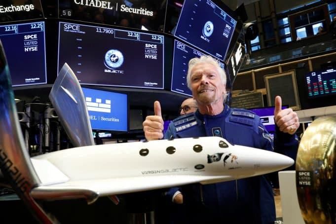 Stocks making the biggest moves midday: Apple, Legg Mason, Virgin Galactic, Tesla and more