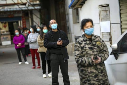 Italian virus death toll nears China's as outbreak spreads