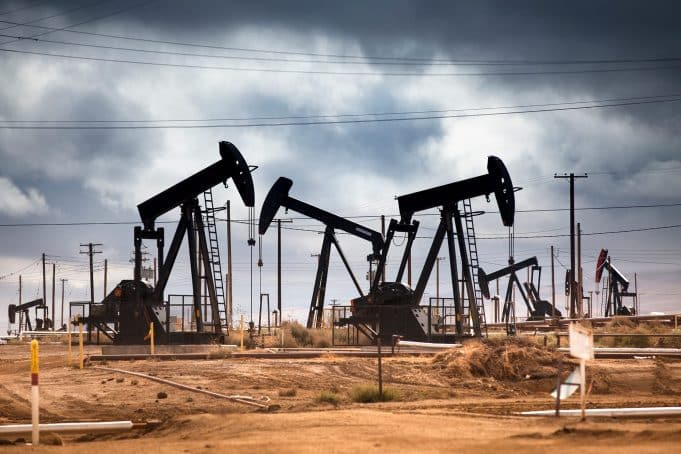 U.S. oil industry pumps near record volumes even as demand and prices collapse