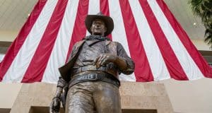Leaders want John Wayne name, statue gone from Orange County airport